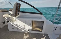 photo of fridge and lower helm seating on cabo 41