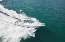 photo of Gorgeous Cabo Yachts 41 running in green water