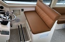 photo of helm seat in heated enclosure